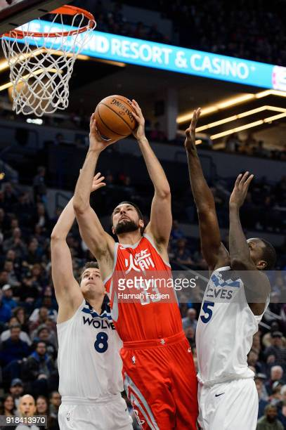Ryan Anderson of the Houston Rockets shoots the ball against Nemanja Bjelica and Gorgui Dieng of the Minnesota Timberwolves during the game on...