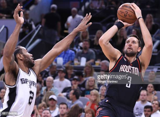 Ryan Anderson of the Houston Rockets takes a shot against Kawhi Leonard of the San Antonio Spurs in the second quarter during Game Five of the...
