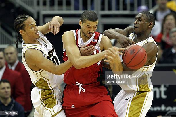 Ryan Anderson of the Nebraska Cornhuskers is doubleteammed by Mike Dixon Jr #10 and JT Tiller of the Missouri Tigers in the first half during the...