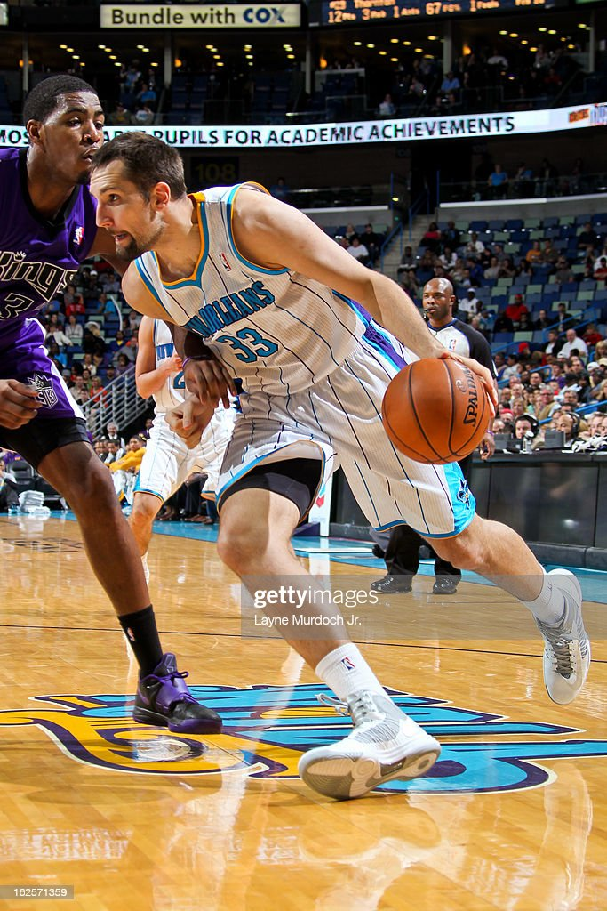 Ryan Anderson #33 of the New Orleans Hornets drives against Jason Thompson #34 of the Sacramento Kings on February 24, 2013 at the New Orleans Arena in New Orleans, Louisiana.