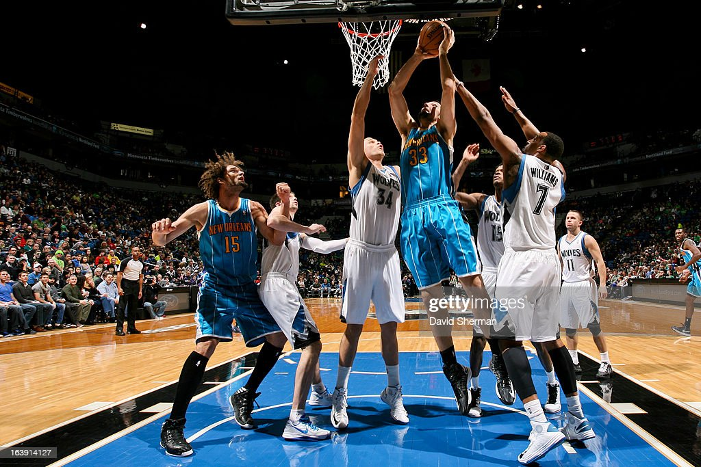 Ryan Anderson #33 of the New Orleans Hornets drives to the basket against Greg Stiemsma #34 of the Minnesota Timberwolves on March 17, 2013 at Target Center in Minneapolis, Minnesota.