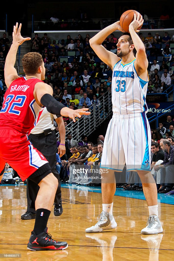 Ryan Anderson #33 of the New Orleans Hornets looks to pass the ball against Blake Griffin #32 of the Los Angeles Clippers on March 27, 2013 at the New Orleans Arena in New Orleans, Louisiana.