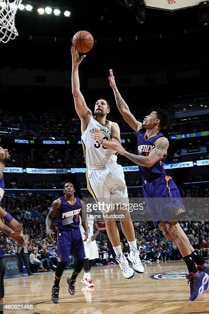 Ryan Anderson of the New Orleans Pelicans drives against the Phoenix Suns on December 30 2014 at Smoothie King Center in New Orleans Louisiana NOTE...