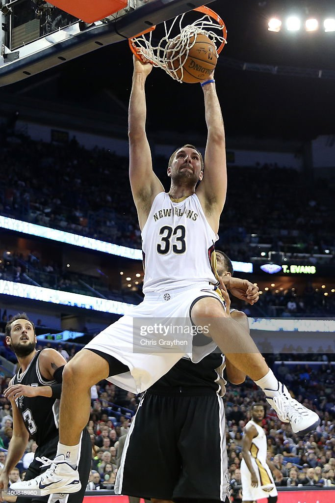 Ryan Anderson #33 of the New Orleans Pelicans dunks the ball against the San Antonio Spurs at Smoothie King Center on December 26, 2014 in New Orleans, Louisiana.