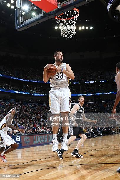 Ryan Anderson of the New Orleans Pelicans grabs a rebound against the San Antonio Spurs on December 26 2014 at Smoothie King Center in New Orleans...