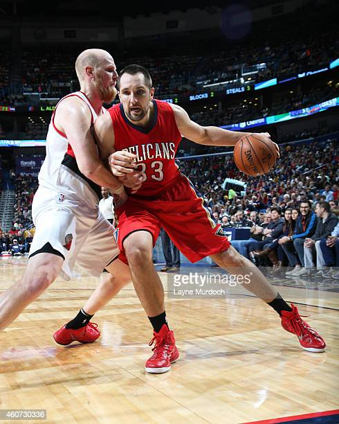 Ryan Anderson of the New Orleans Pelicans handles the ball against the Portland Trail Blazers on December 20 2014 at Smoothie King Center in New...