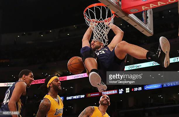 Ryan Anderson of the New Orleans Pelicans hangs on the rim after a dunk in the first half during the NBA game against the Los Angeles Lakers at...