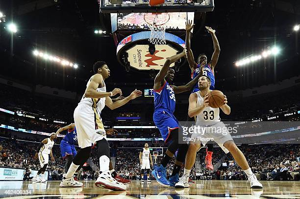 Ryan Anderson of the New Orleans Pelicans is defended by Henry Sims and Jerami Grant of the Philadelphia 76ers during the first half of a game at the...