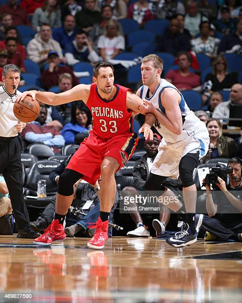 Ryan Anderson of the New Orleans Pelicans looks to move the ball against the Minnesota Timberwolves during the game on April 13 2015 at Target Center...