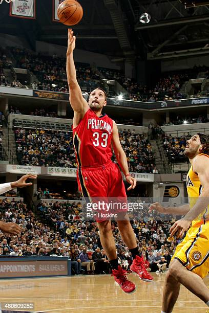Ryan Anderson of the New Orleans Pelicans shoots against the Indiana Pacers on December 23 2014 at Bankers Life Fieldhouse in Indianapolis Indiana...