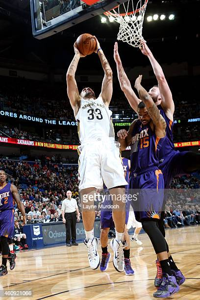 Ryan Anderson of the New Orleans Pelicans shoots against the Phoenix Suns on December 30 2014 at Smoothie King Center in New Orleans Louisiana NOTE...