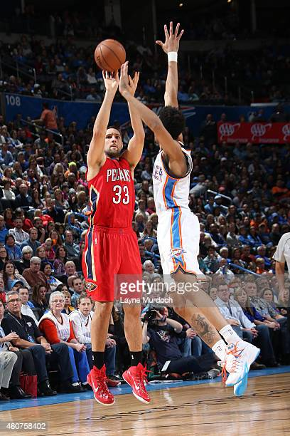 Ryan Anderson of the New Orleans Pelicans takes a shot against the Oklahoma City Thunder on December 21 2014 at Chesapeake Energy Arena in Oklahoma...