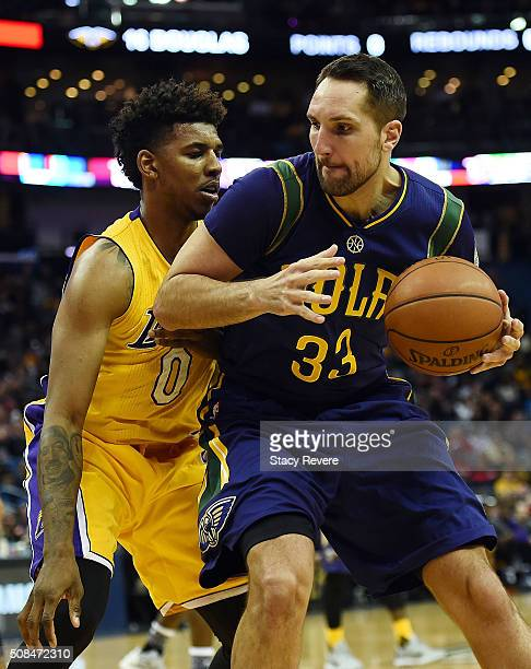 Ryan Anderson of the New Orleans Pelicans works against Nick Young of the Los Angeles Lakers during the first half of a game at the Smoothie King...