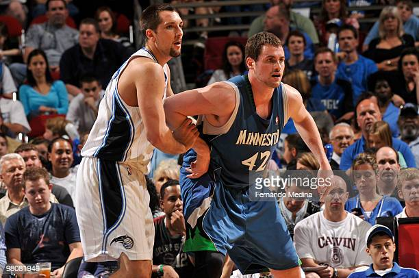 Ryan Anderson of the Orlando Magic bodies up against Kevin Love of the Minnesota Timberwolves during the game on March 26, 2010 at Amway Arena in...