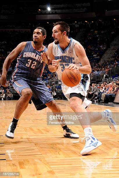 Ryan Anderson of the Orlando Magic drives to the basket against Boris Diaw of the Charlotte Bobcats] during the game on January 17 2012 at Amway...