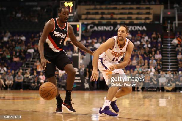 Ryan Anderson of the Phoenix Suns passes the ball around AlFarouq Aminu of the Portland Trail Blazers during the NBA preseason game at Talking Stick...