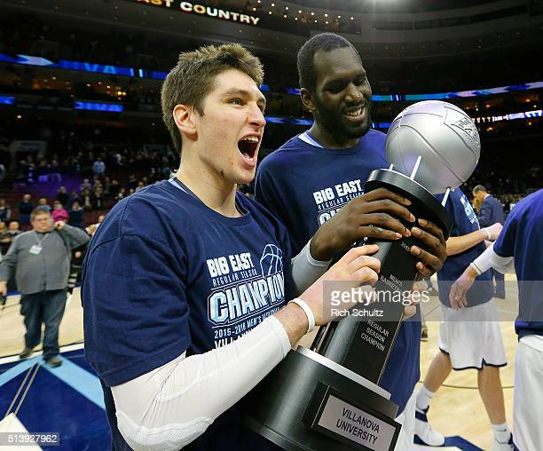Ryan Arcidiacono and Daniel Ochefu of the Villanova Wildcats hold the Big East Regular Season Championship trophy after defeating the Georgetown...