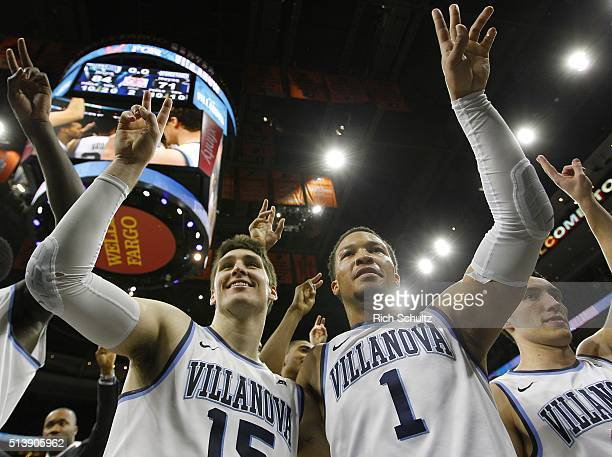 Ryan Arcidiacono and Jalen Brunson of the Villanova Wildcats celebrate their 8471 win over the Georgetown Hoyas in an NCAA college basketball game on...
