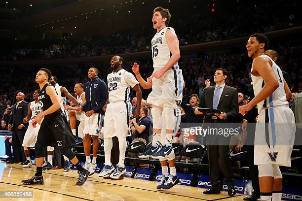 Ryan Arcidiacono JayVaughn Pinkston and Josh Hart of the Villanova Wildcats celebrate on the bench in the closing minutes of the championship game of...