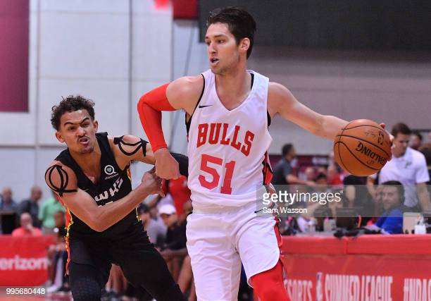 Ryan Arcidiacono of the Chicago Bulls drives against Trae Young of the Atlanta Hawks during the 2018 NBA Summer League at the Cox Pavilion on July 10...