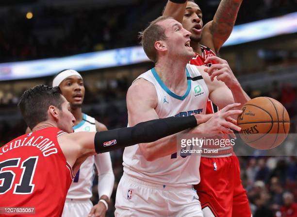 Ryan Arcidiacono of the Chicago Bulls fouls Cody Zeller of the Charlotte Hornets at the United Center on February 20, 2020 in Chicago, Illinois. NOTE...