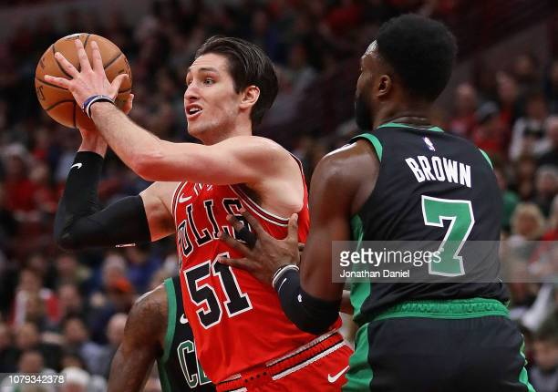 Ryan Arcidiacono of the Chicago Bulls passes under pressure from Jaylen Brown of the Boston Celtics at United Center on December 08 2018 in Chicago...