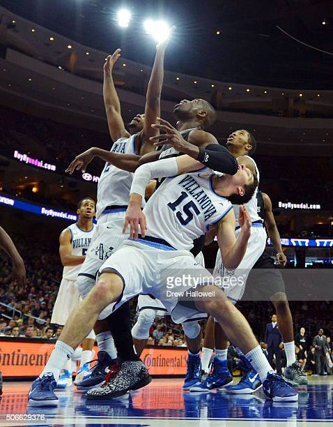 Ryan Arcidiacono of the Villanova Wildcats catches an elbow from Ben Bentil of the Providence Friars at the Wells Fargo Center on January 24 2016 in...
