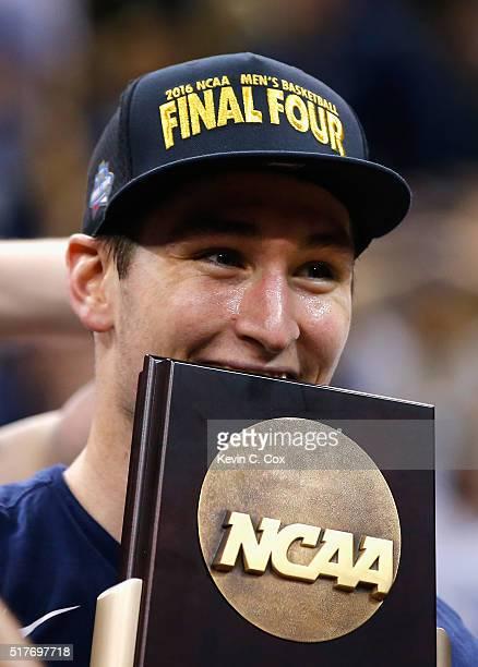 Ryan Arcidiacono of the Villanova Wildcats celebrates defeating the Kansas Jayhawks 64-59 during the 2016 NCAA Men's Basketball Tournament South...