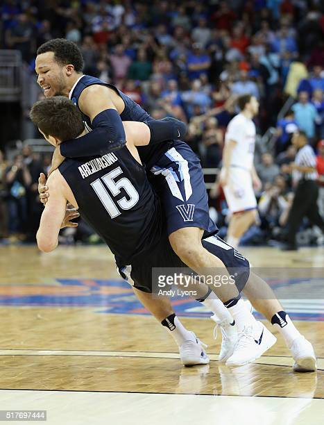 Ryan Arcidiacono of the Villanova Wildcats celebrates with Jalen Brunson after defeating the Kansas Jayhawks 6459 during the 2016 NCAA Men's...