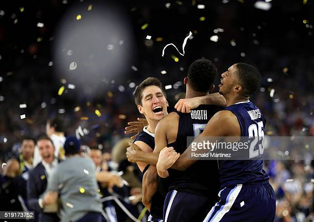 Ryan Arcidiacono of the Villanova Wildcats celebrates with Phil Booth and Mikal Bridges after defeating the North Carolina Tar Heels 7774 to win the...