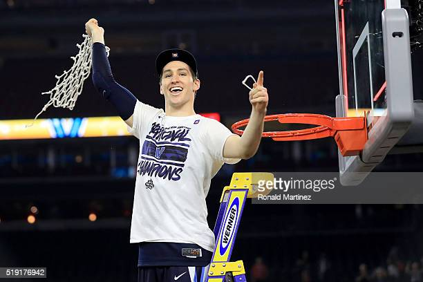 Ryan Arcidiacono of the Villanova Wildcats cuts the net after defeating the North Carolina Tar Heels 7774 to win the 2016 NCAA Men's Final Four...