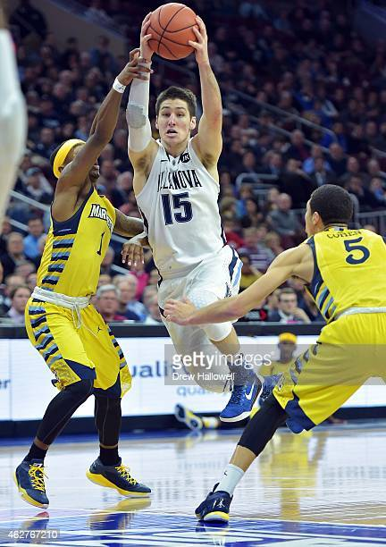 Ryan Arcidiacono of the Villanova Wildcats drives the lane between Duane Wilson and Sandy Cohen III of the Marquette Golden Eagles at the Wells Fargo...