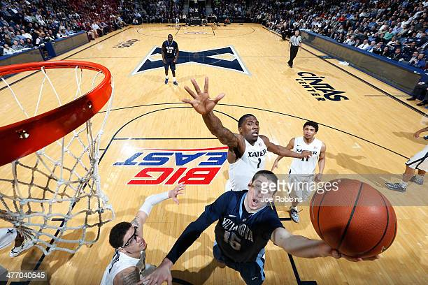 Ryan Arcidiacono of the Villanova Wildcats drives to the basket against Jalen Reynolds of the Xavier Musketeers during the game at Cintas Center on...