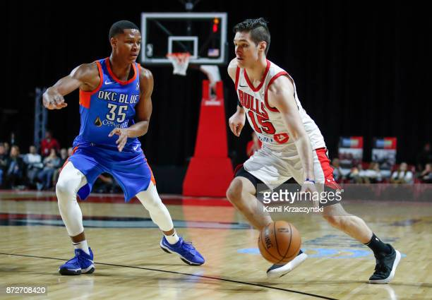 Ryan Arcidiacono of the Windy City Bulls is defended by PJ Dozier of the Oklahoma City Blue during the second half of an NBA GLeague game on November...