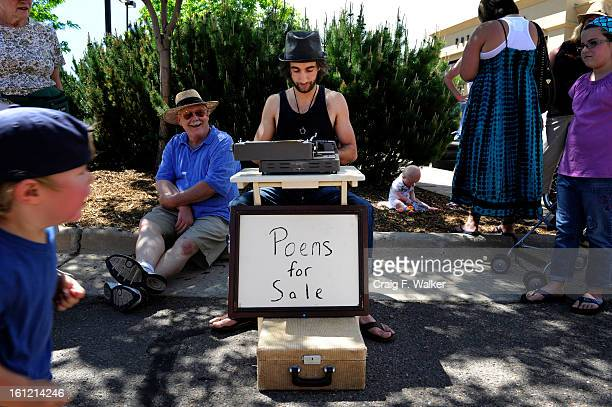 Ryan Ashley Knowles of Untouched Poetry writes poetry for donations during A Paris Street Market at Aspen Grove in Littleton CO Saturday May 05 2012...