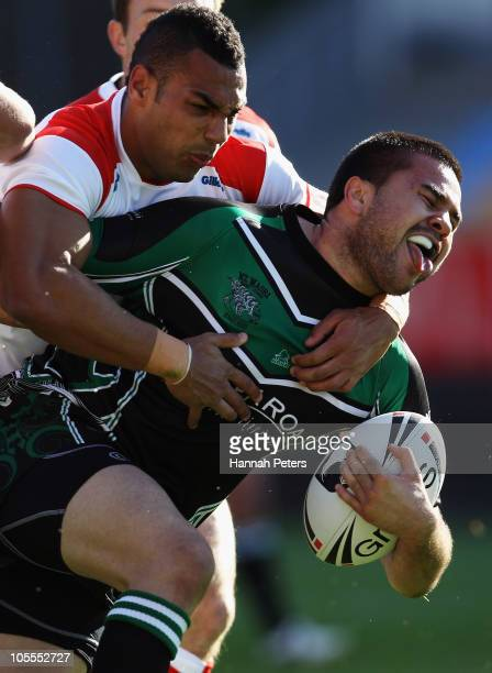 Ryan Atkins of England tackles Justin Horo of New Zealand Maori during the international match between New Zealand Maori and England at Mt Smart...
