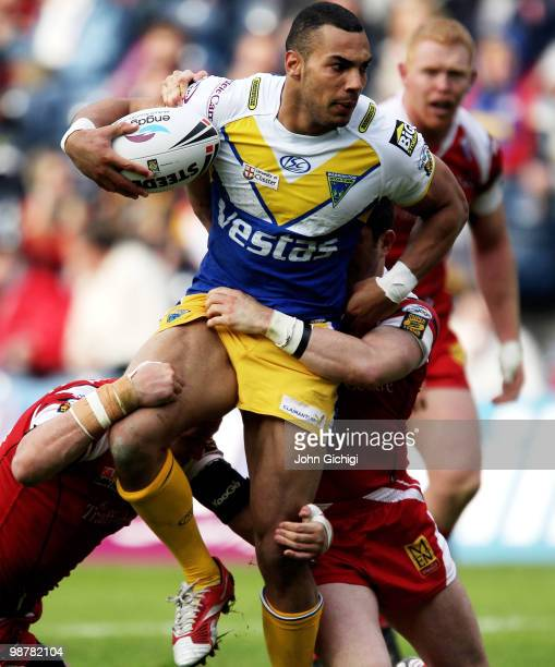 Ryan Atkins of Warrington is held up by the defence during the Engage Super League Magic Weekend game between Salford City Reds and Warrington Wolves...