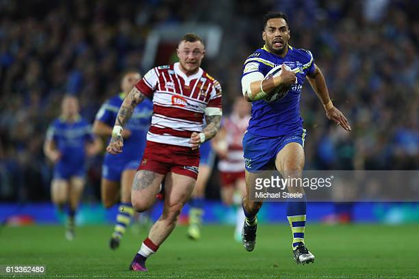 Ryan Atkins of Warrington is pursued by Josh Charnley of Wigan during the First Utility Super League Final between Warrington Wolves and Wigan...