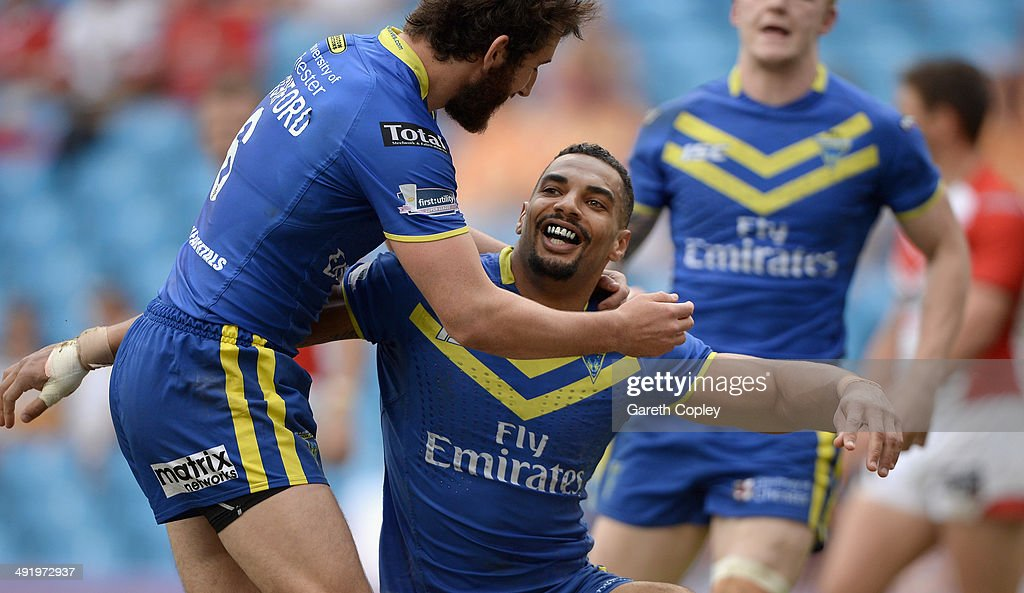 Ryan Atkins of Warrington Wolves celebrates scoring his team's 5th try during the Super League match between Warrington Wolves and St Helens at Etihad Stadium on May 18, 2014 in Manchester, England.