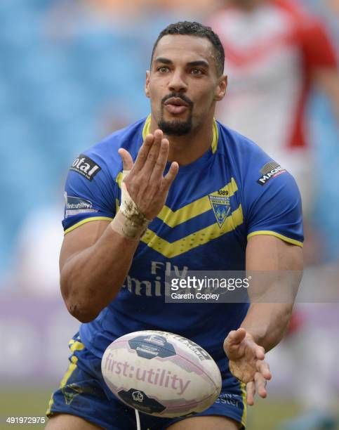 Ryan Atkins of Warrington Wolves celebrates scoring his team's 5th try during the Super League match between Warrington Wolves and St Helens at...