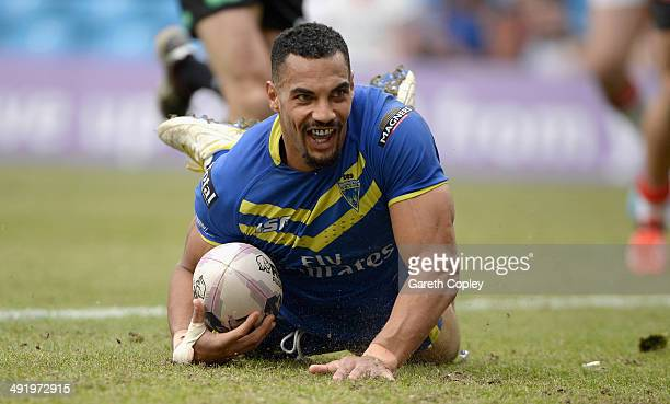 Ryan Atkins of Warrington Wolves scores his team's 5th try during the Super League match between Warrington Wolves and St Helens at Etihad Stadium on...