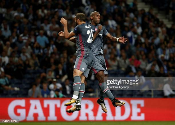 Ryan Babel and Cenk Tosun of Besiktas celebrate after scoring a goal during the UEFA Champions League Group G match between Porto and Besiktas at...