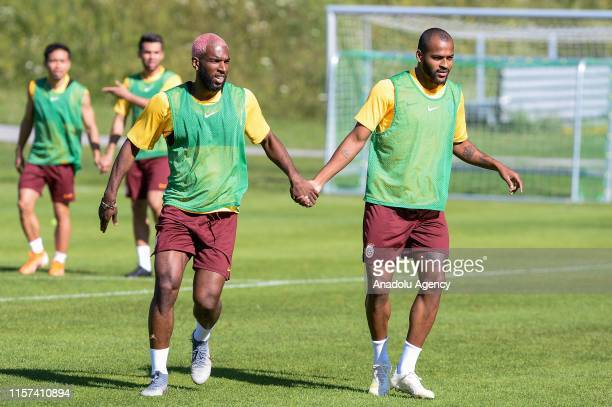 Ryan Babel and Marcao from Galatasaray hold hands as part of an exercise during a training session within summer camp as part of the Turkish Super...