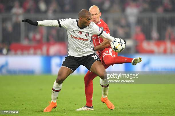 Ryan Babel ob Besiktas and Arjen Robben of Bayern Muenchen compete for the ball during the UEFA Champions League Round of 16 First Leg match between...
