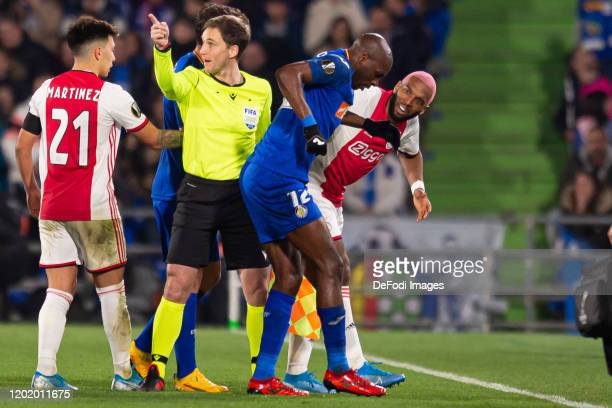 Ryan Babel of AFC Ajax and AllanRomeo Nyom of Getafe CF gesture during the UEFA Europa League round of 32 first leg match between Getafe CF and AFC...