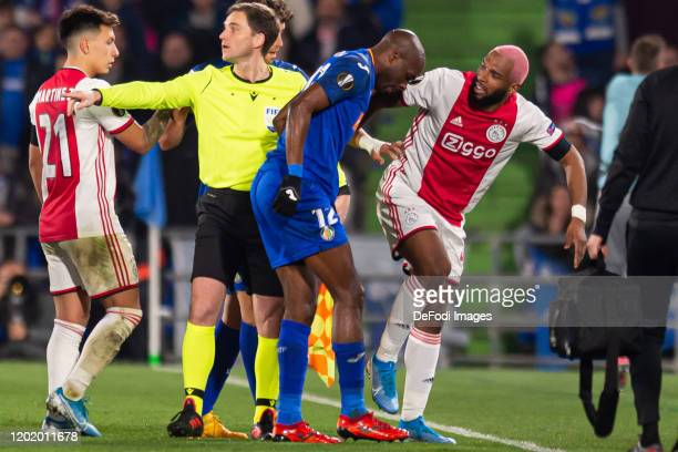 Ryan Babel of AFC Ajax and Allan-Romeo Nyom of Getafe CF gesture during the UEFA Europa League round of 32 first leg match between Getafe CF and AFC...