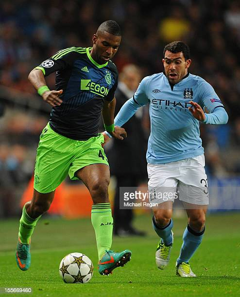 Ryan Babel of Ajax competes with Carlos Tevez of Manchester City during the UEFA Champions League Group D match between Manchester City FC and Ajax...