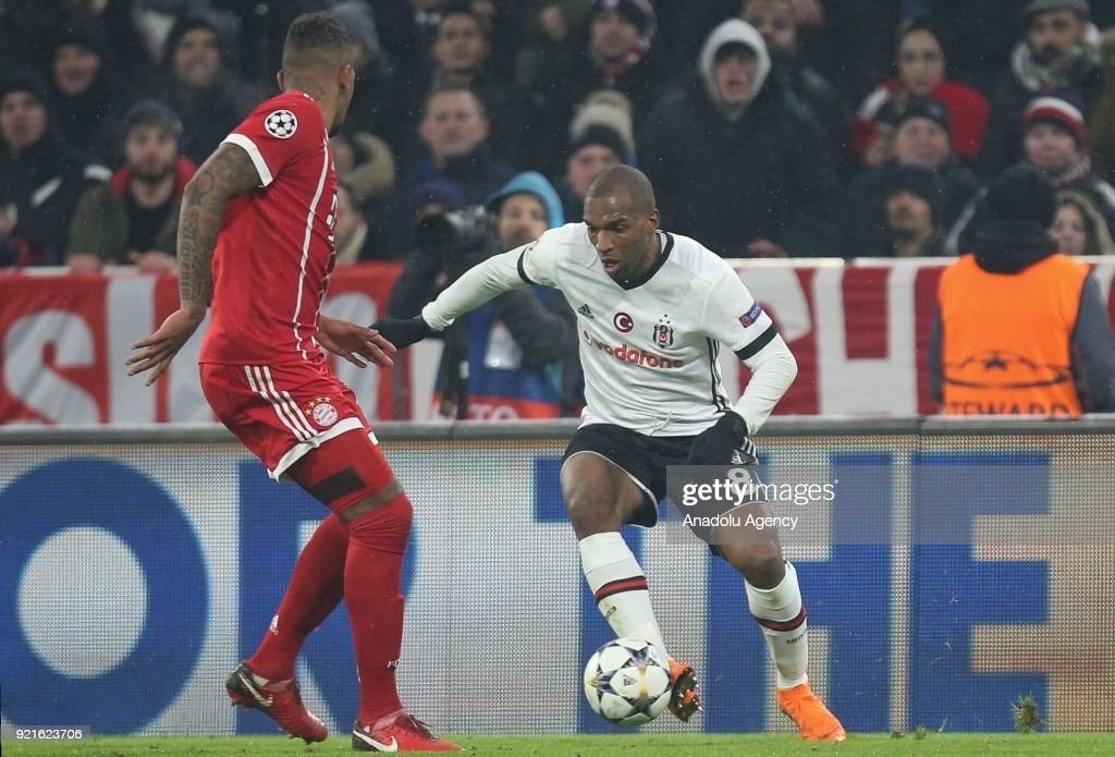 Ryan Babel of Besiktas (R) in action against Jerome Boateng of Bayern Munich during the UEFA Champions League Round of 16 soccer match between FC Bayern Munich and Besiktas at the Allianz Arena in Munich, Germany, on February 20, 2018.