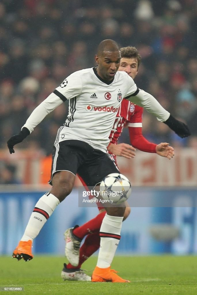 Ryan Babel of Besiktas (front) in action against Thomas Mueller of Bayern Munich during the UEFA Champions League Round of 16 soccer match between FC Bayern Munich and Besiktas at the Allianz Arena in Munich, Germany, on February 20, 2018.