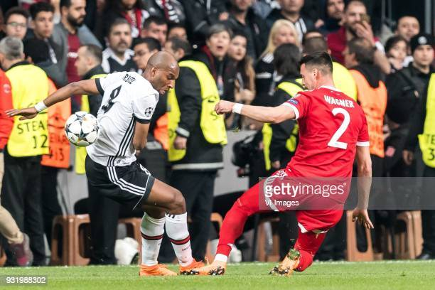 Ryan Babel of Besiktas JK Sandro Wagner of FC Bayern Munich during the UEFA Champions League round of 16 match between Besiktas AS and Bayern Munchen...